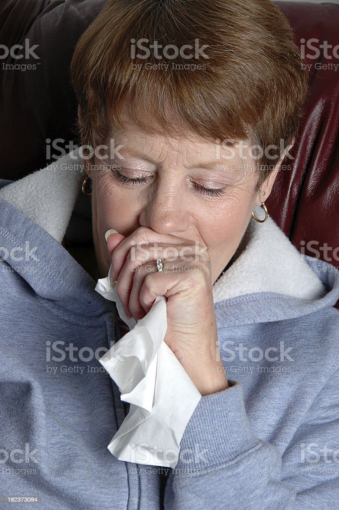 Senior Woman Coughing Into Hand royalty-free stock photo