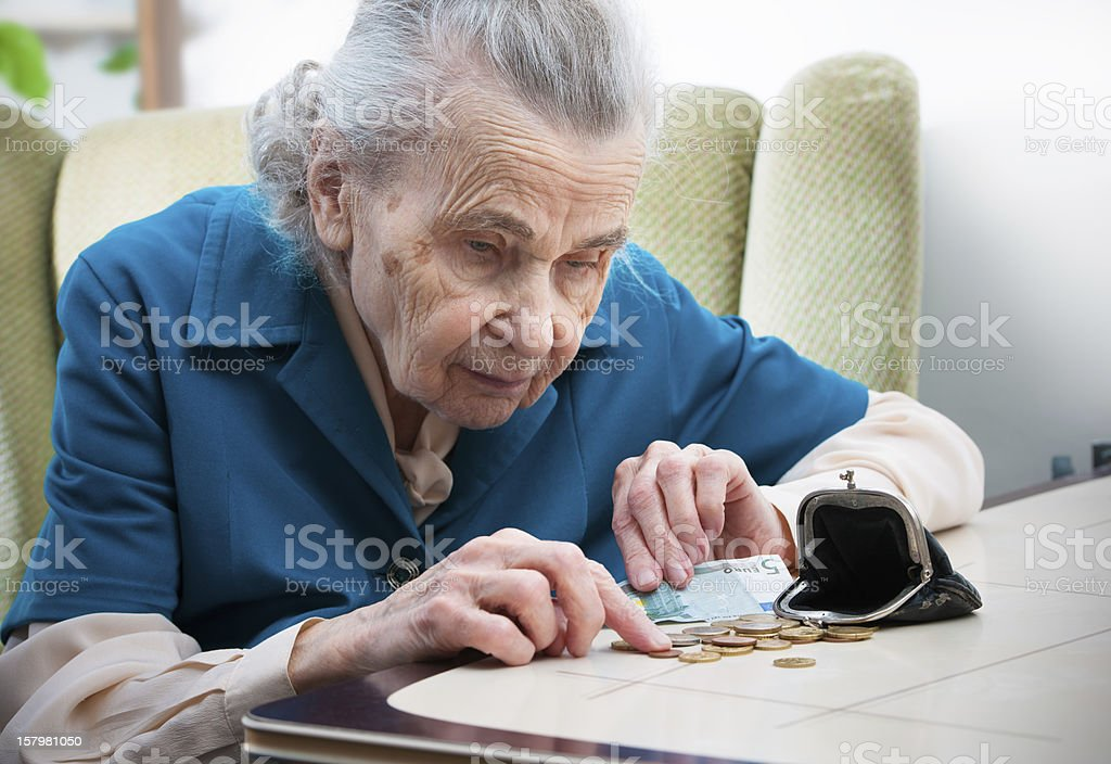 Senior woman counting money stock photo