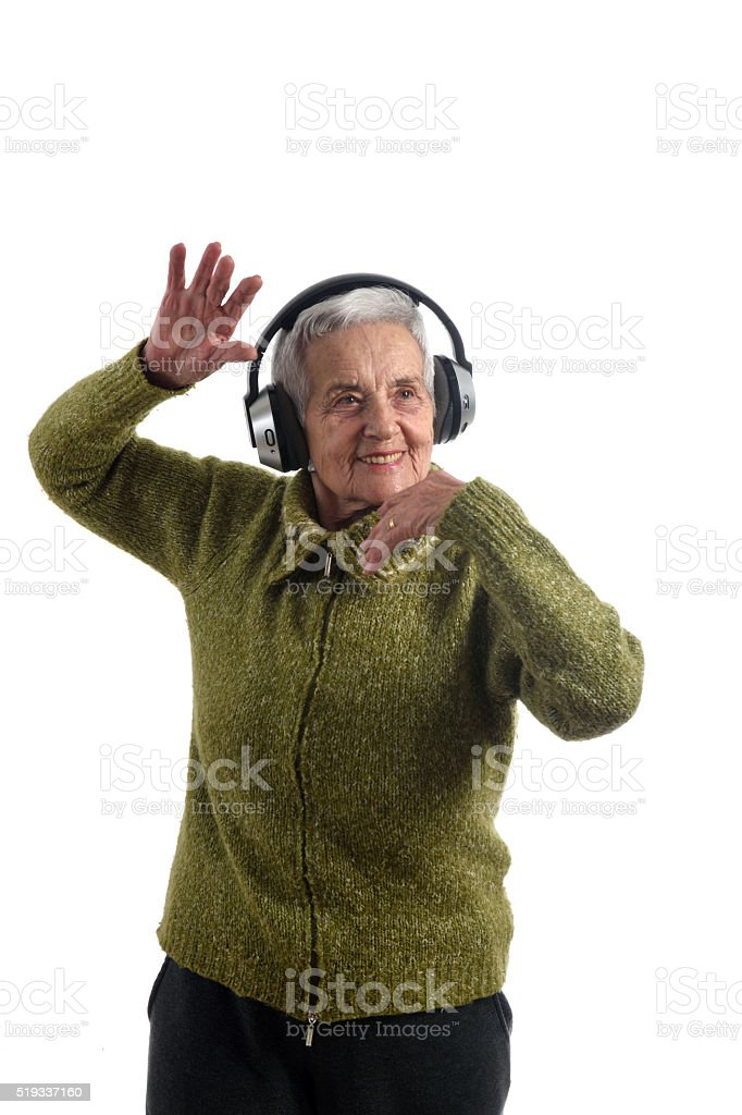 Senior woman dancing with white background stock photo