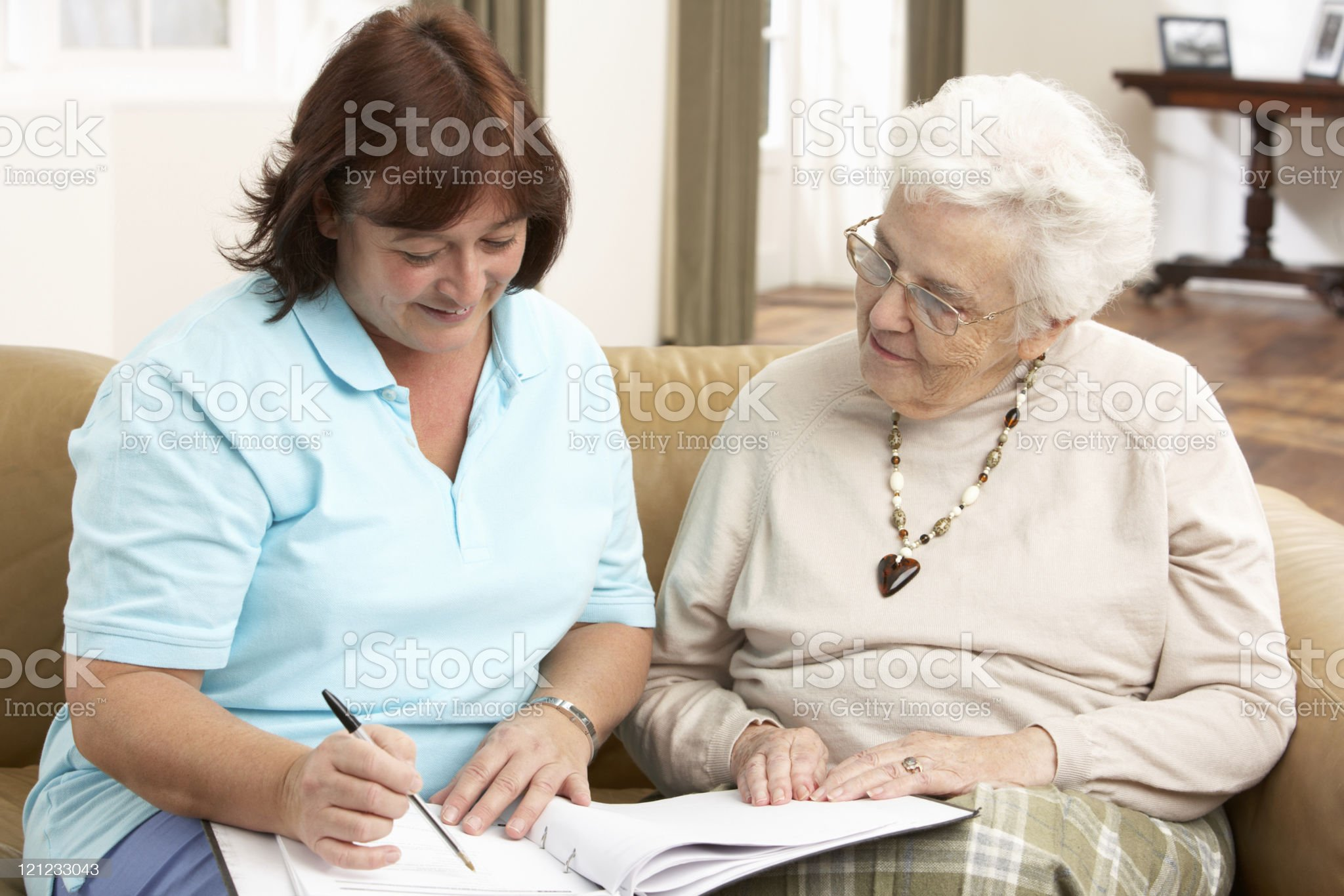 Senior woman discussing health issues with a visitor royalty-free stock photo