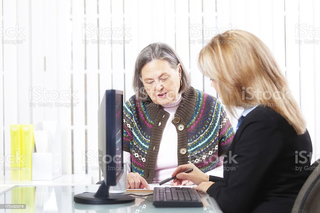 Senior Woman Discussing with Banking and Financial Advisor Hz royalty-free stock photo