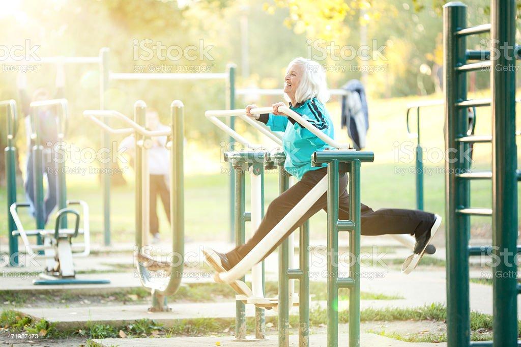 Senior Woman doing Exercises Outdoors stock photo