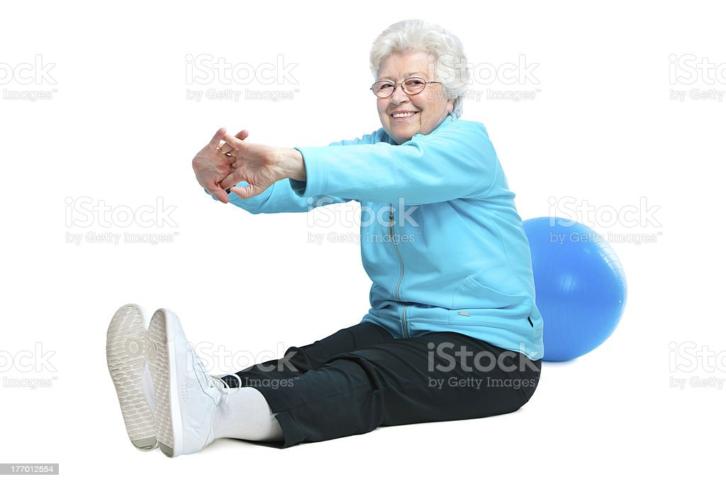 A senior woman doing some stretching exercises stock photo