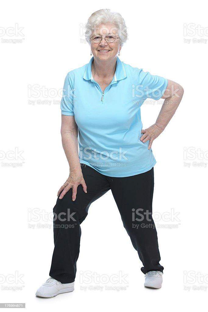 senior woman doing stretching exercises royalty-free stock photo