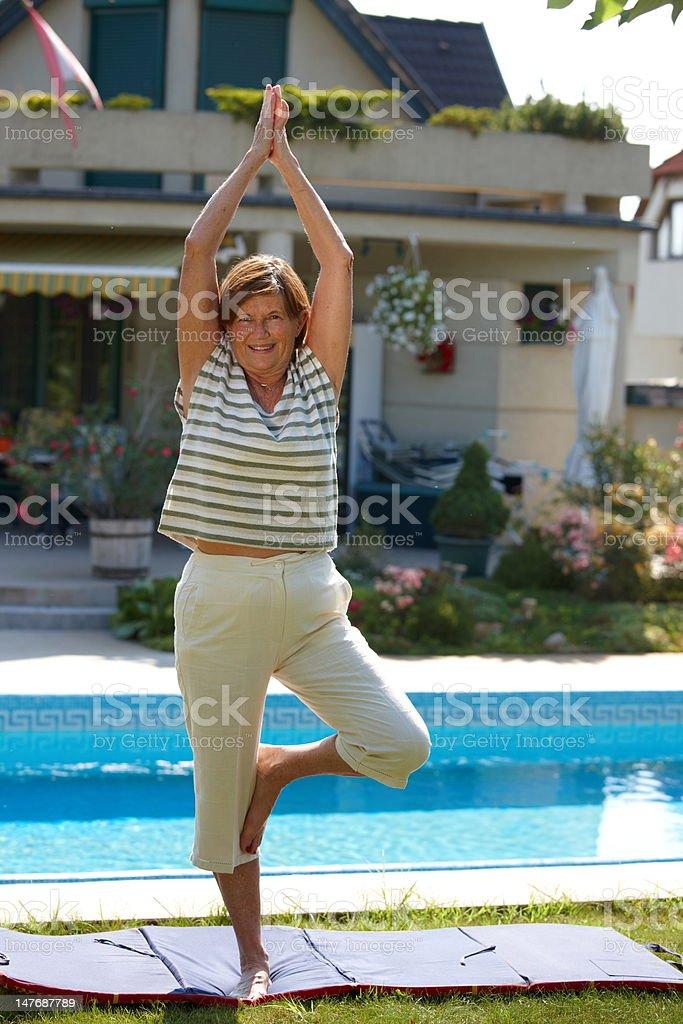 Senior woman doing yoga royalty-free stock photo