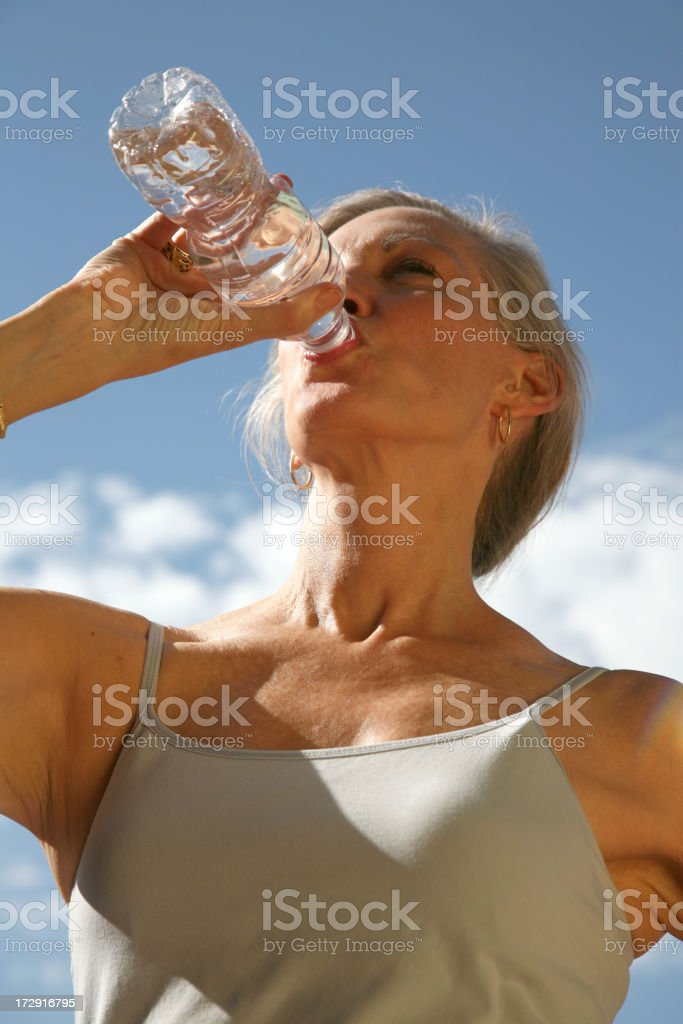 Senior Woman Drinking Bottle Of Water Outside royalty-free stock photo