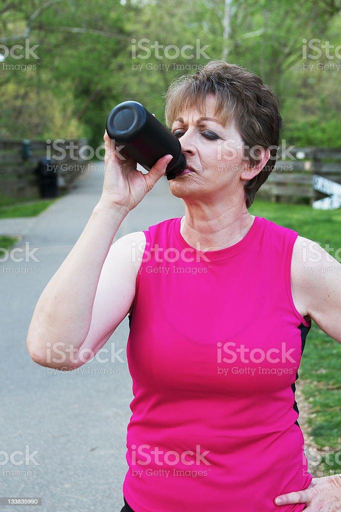 Senior Woman Drinking royalty-free stock photo
