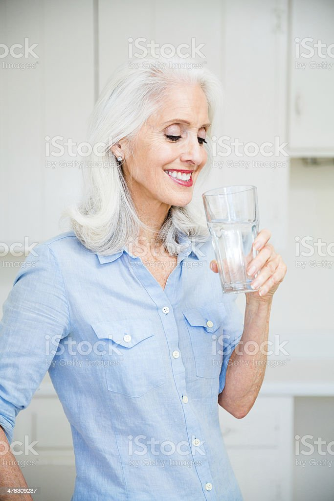 Senior woman drinking water royalty-free stock photo