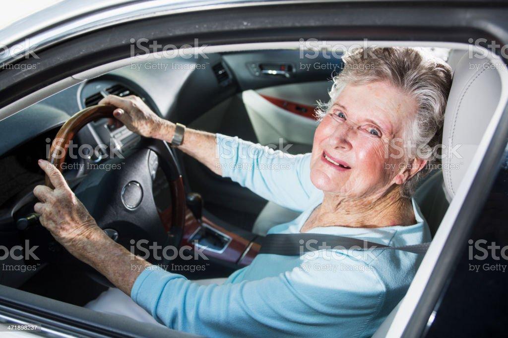 Senior woman driving car stock photo
