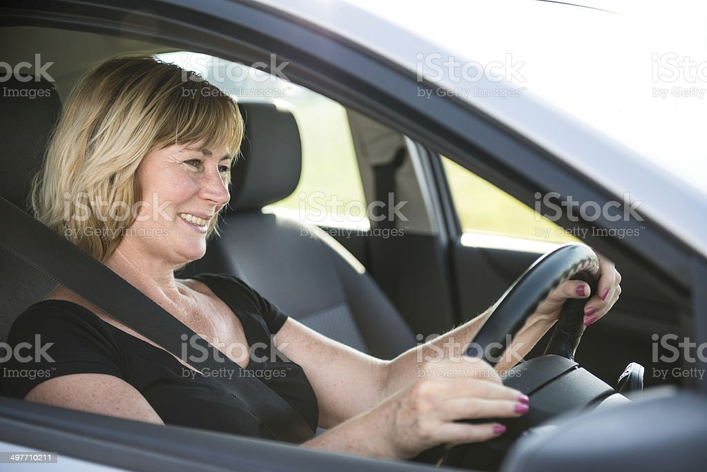 Senior woman driving car royalty-free stock photo
