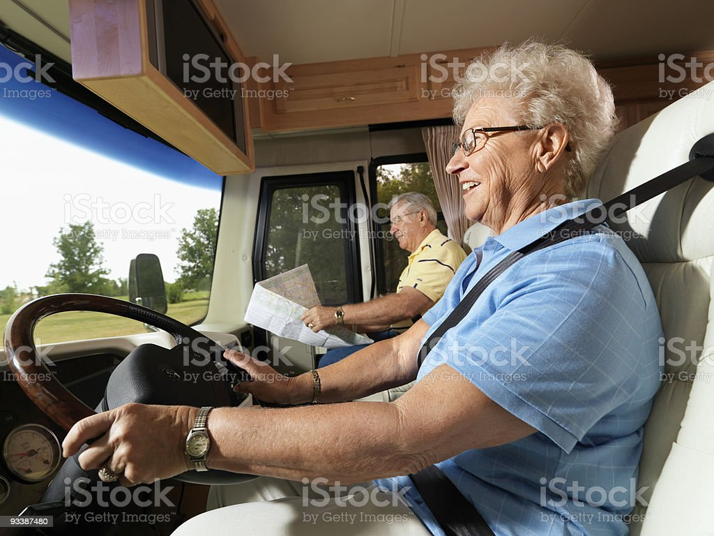 Senior woman driving RV. royalty-free stock photo