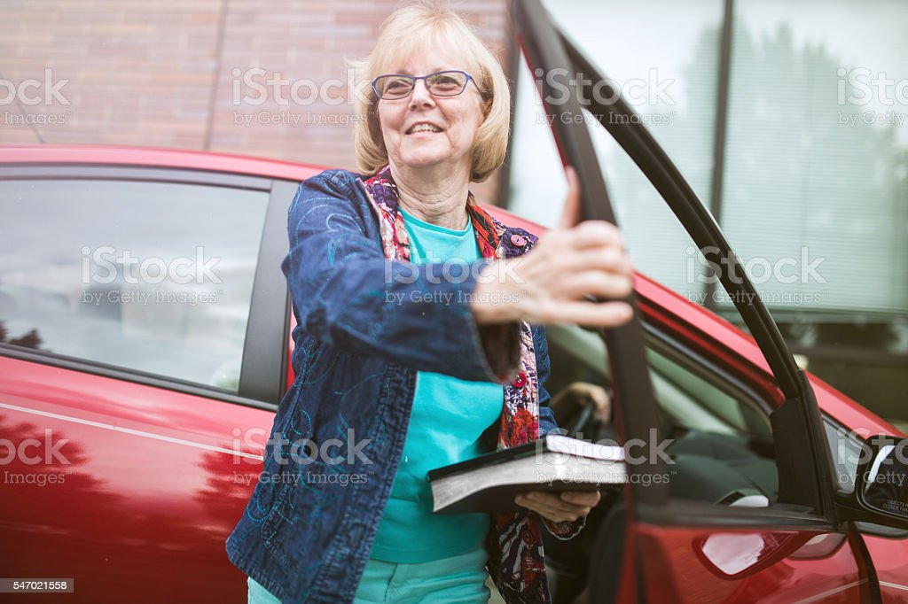 Senior Woman Dropped Off at Library stock photo