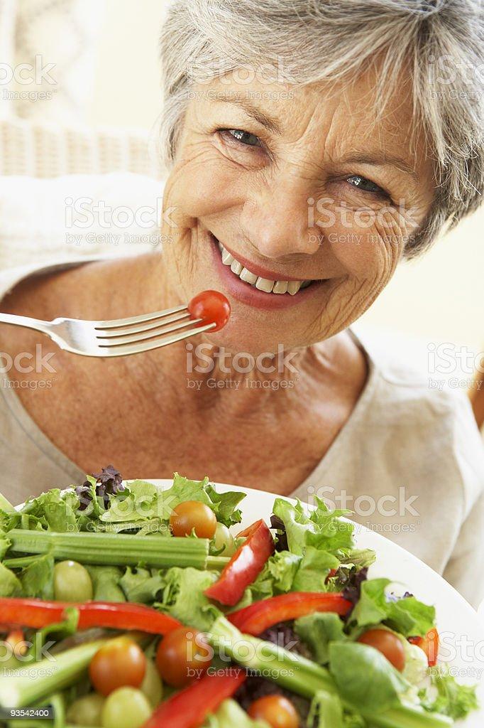 Senior Woman Eating Healthy Salad stock photo