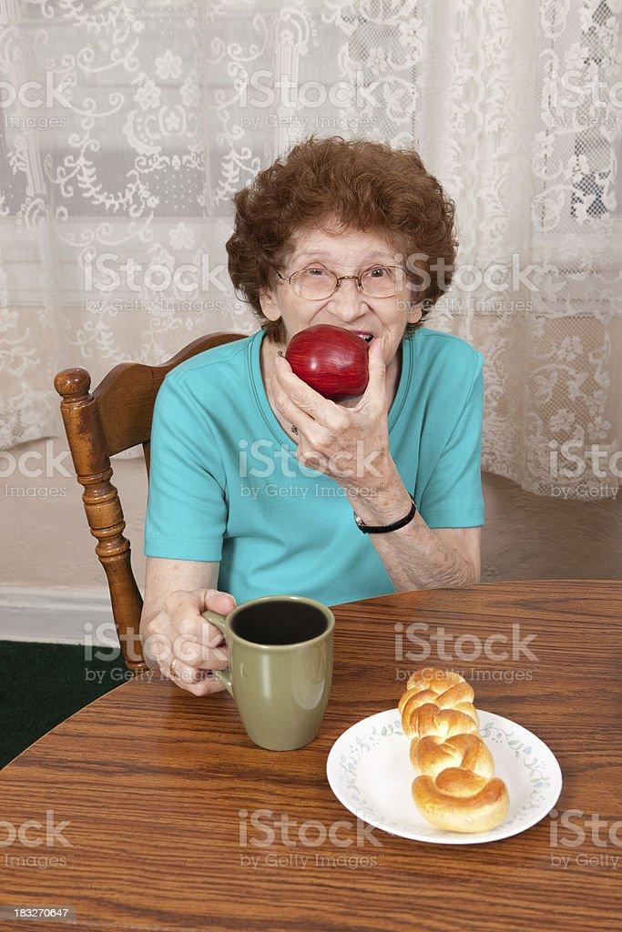 Senior Woman Eating royalty-free stock photo