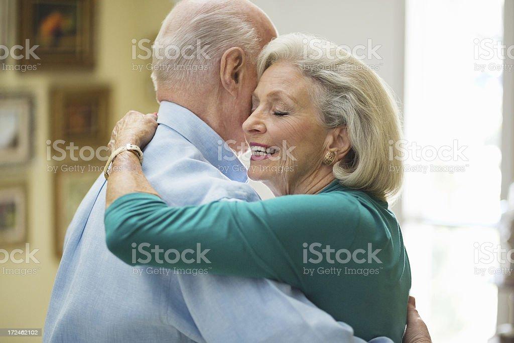 Senior Woman Embracing Man royalty-free stock photo