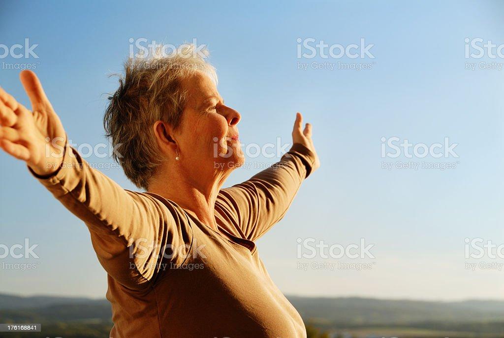 senior woman emracing the world stock photo