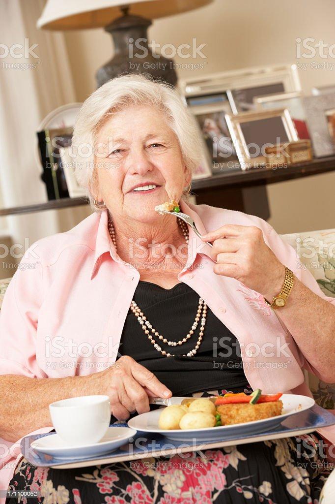 Senior Woman Enjoying Meal At Home royalty-free stock photo