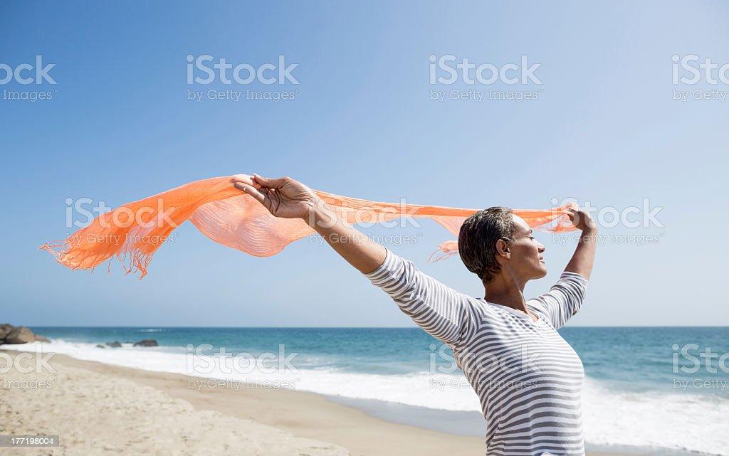 Senior woman enjoying the beach stock photo