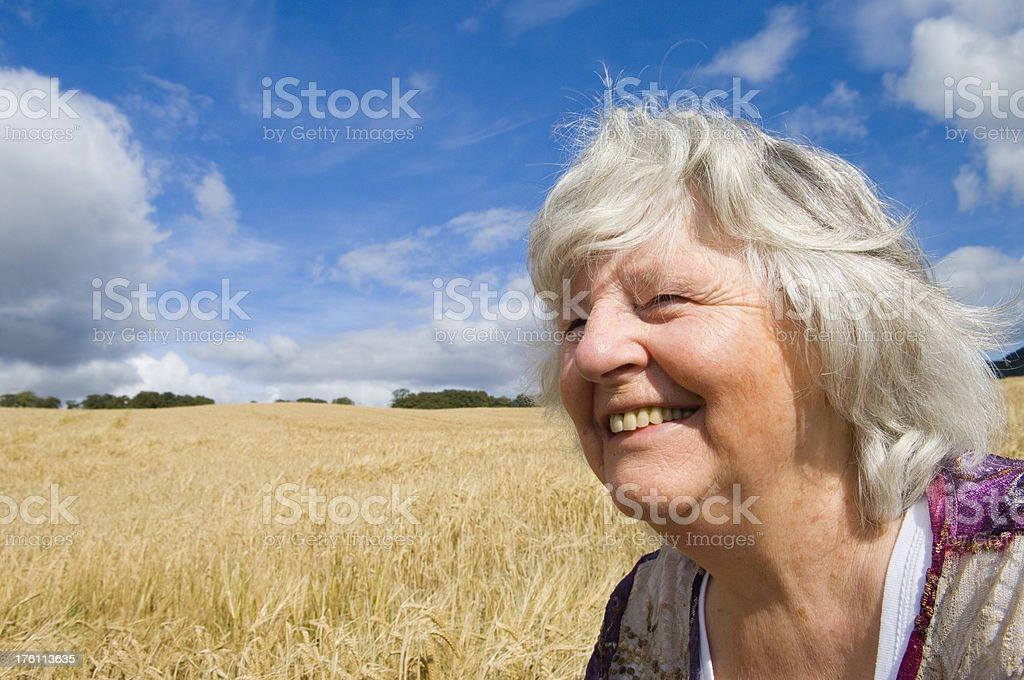 Senior woman enjoying the outdoors stock photo