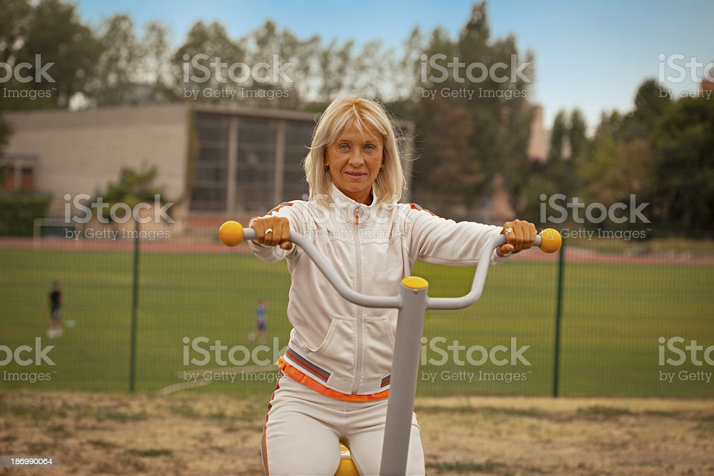 senior woman exercise in sport field royalty-free stock photo