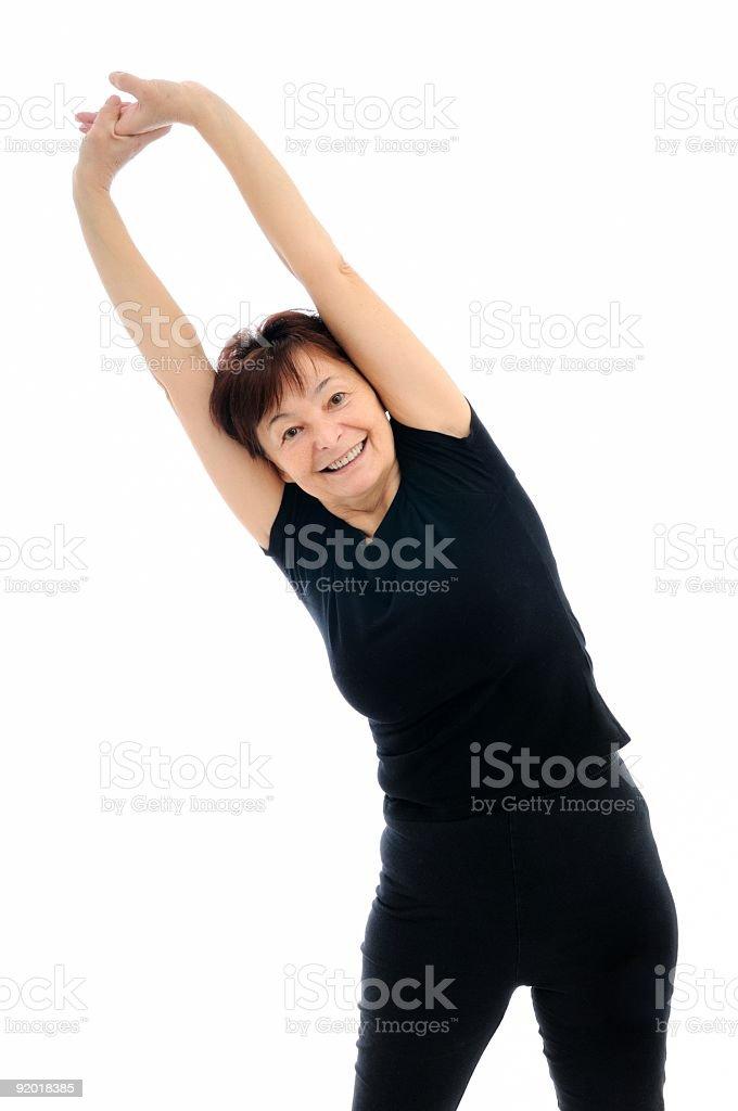 Senior woman exercises royalty-free stock photo