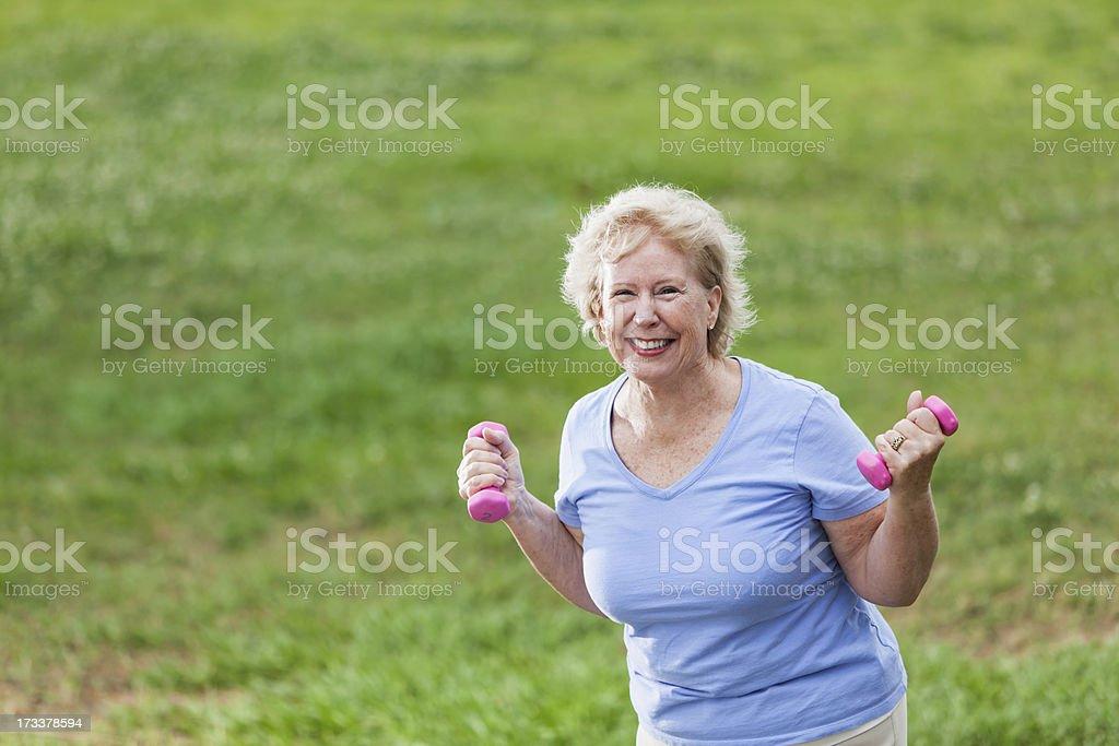 Senior woman exercising in park royalty-free stock photo