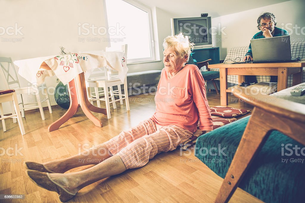 Senior Woman Exercising, Man with Laptop, Brac, Croatia, Europe stock photo