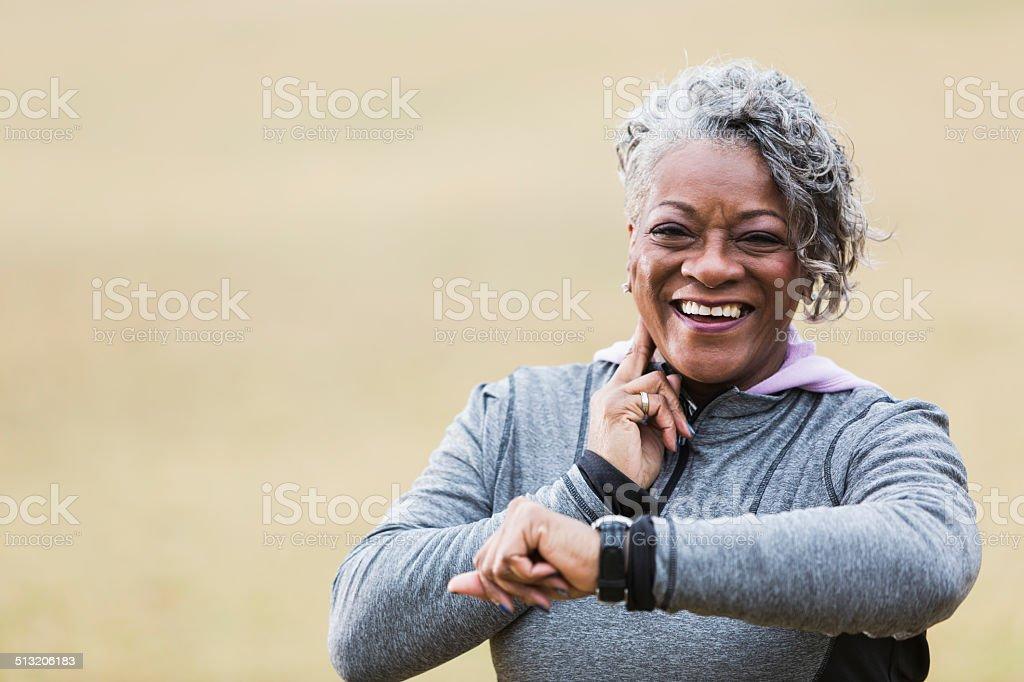 Senior woman exercising, taking pulse stock photo