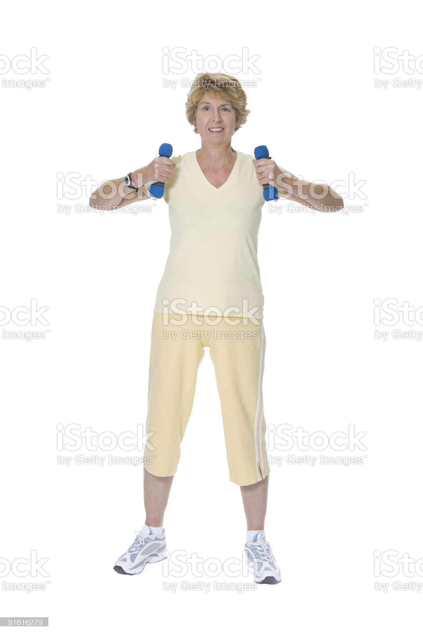 Senior woman exercising with blue weights royalty-free stock photo