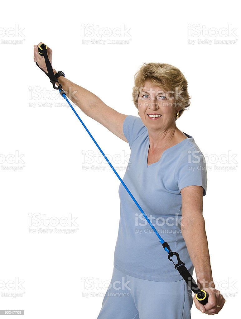 Senior woman exercising with resistance band royalty-free stock photo