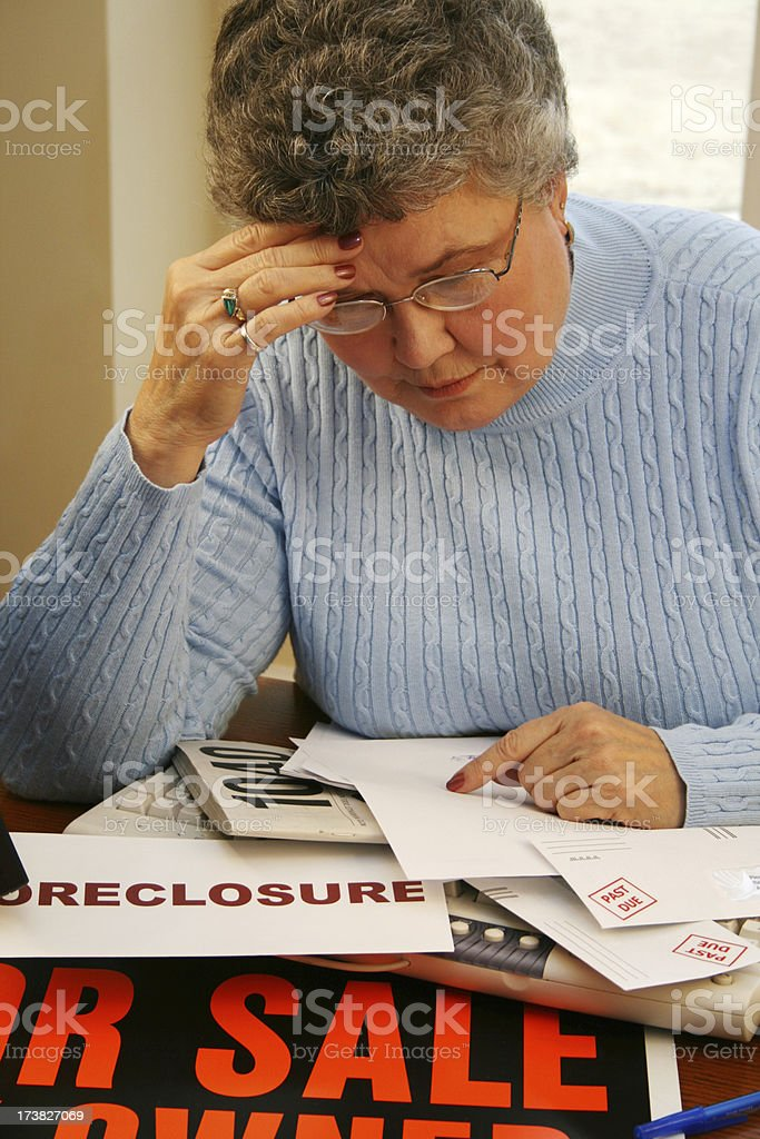Senior Woman Faces Financial Problems royalty-free stock photo