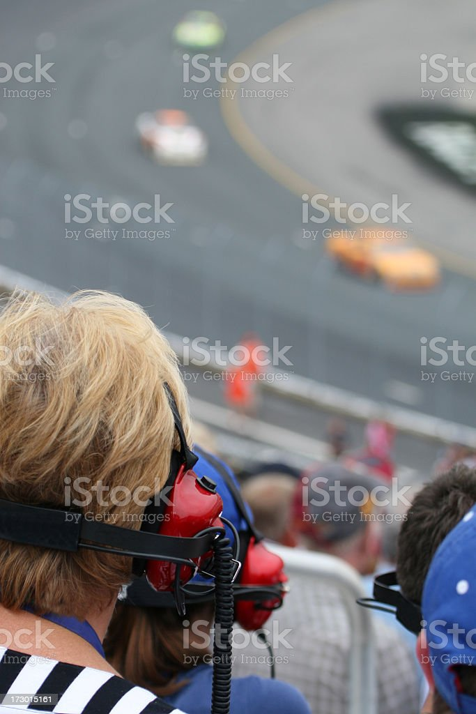 Senior Woman Fan at Racing Event and Looking at Race stock photo