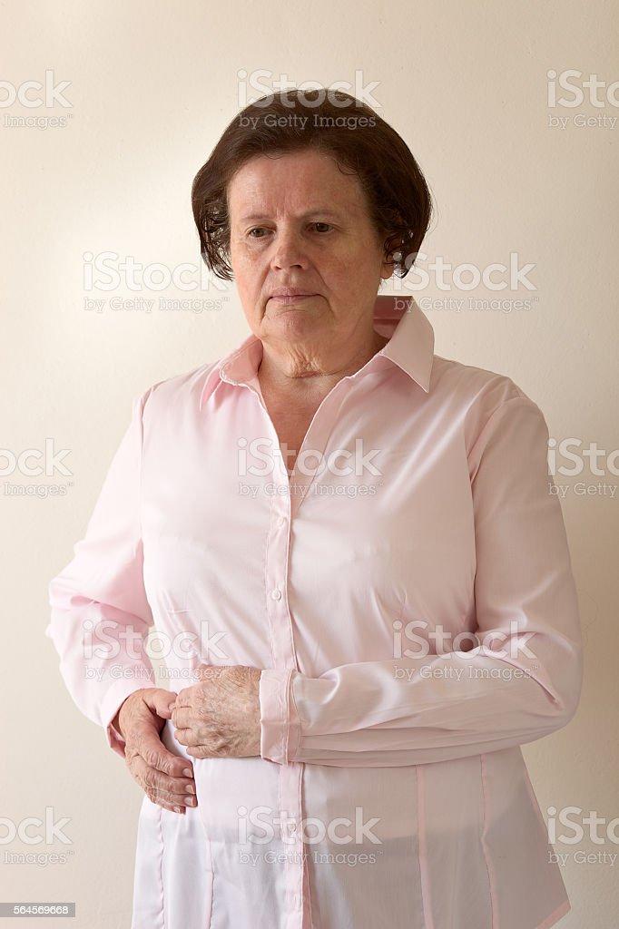 Senior woman feels pain. stock photo