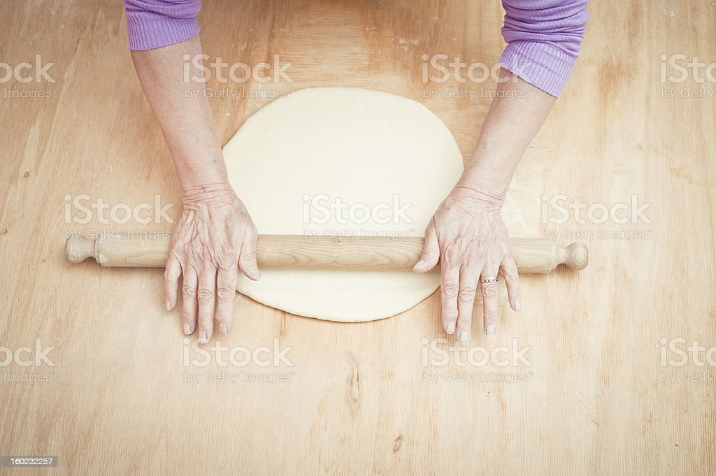 Senior Woman Flattening Dough With A Rolling Pin royalty-free stock photo