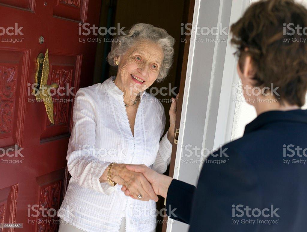 Senior woman friendly handshake stock photo