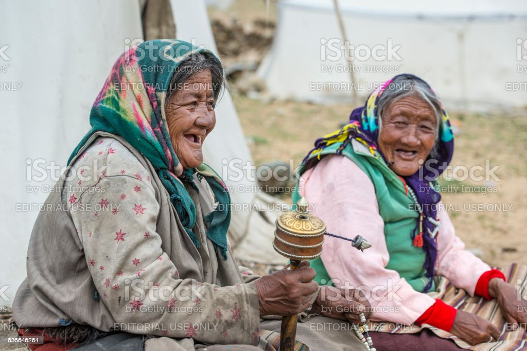 Senior woman from Ladakh sitting in front of their tenthomes stock photo