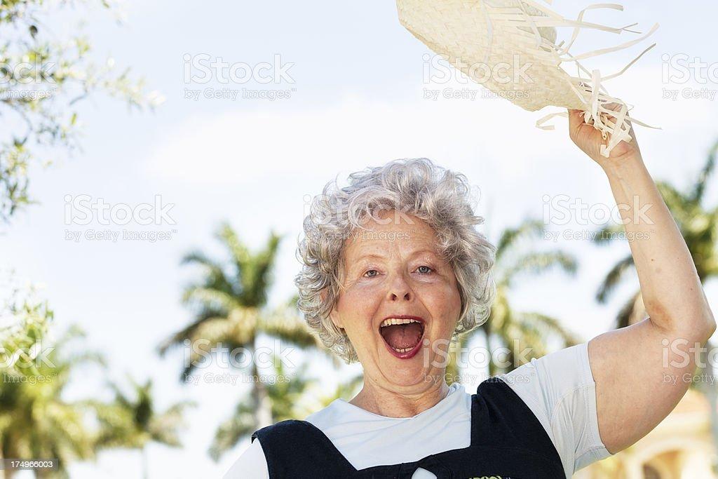 senior woman fun tourist tropical climate stock photo
