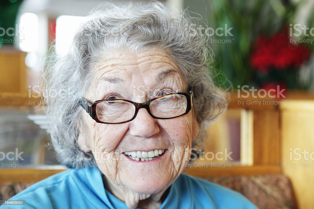 Senior Woman Funny Face Looking Up and Smiling royalty-free stock photo