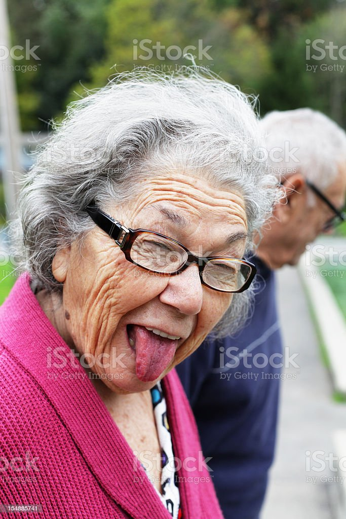 Senior Woman Funny Face Sticking Tongue Out royalty-free stock photo