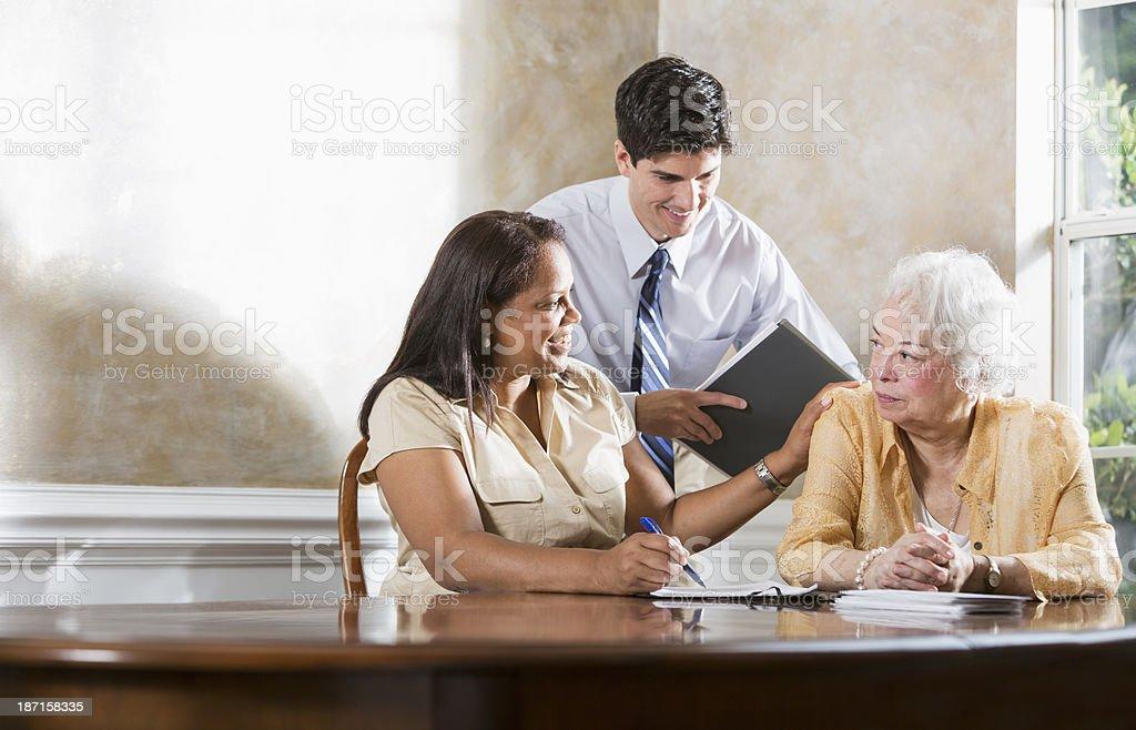 Senior Hispanic woman getting professional advice.