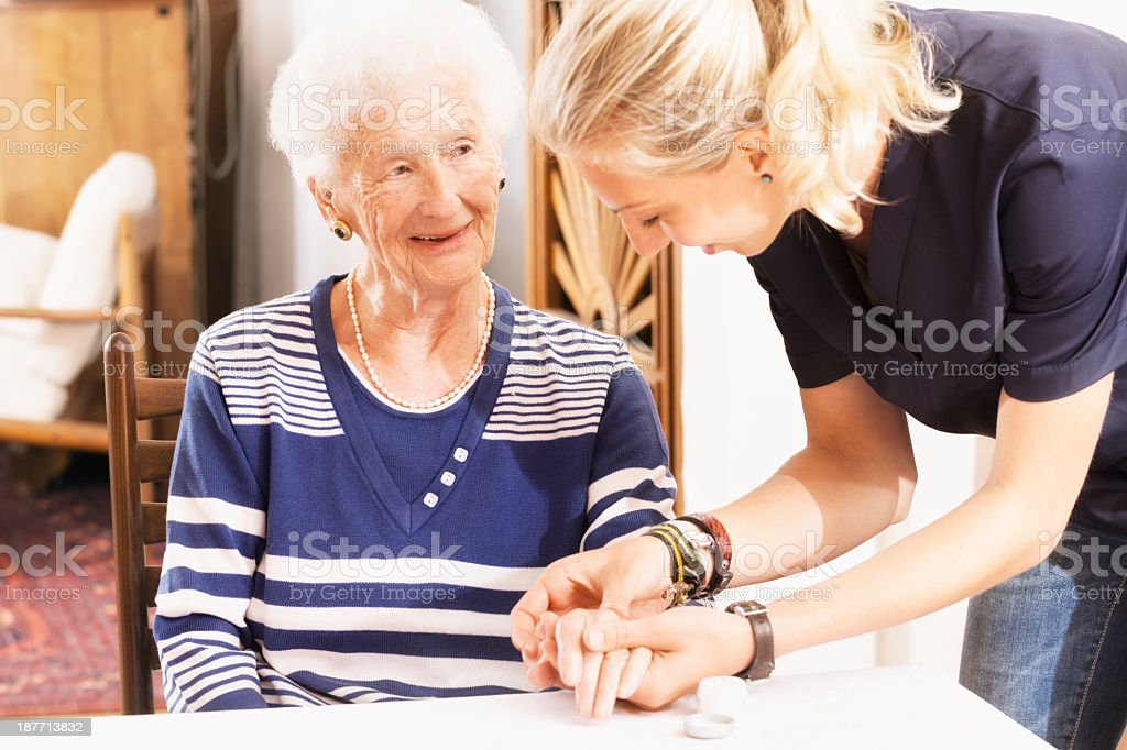 senior woman getting care an assistance stock photo