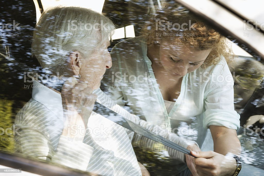 senior woman getting help in car royalty-free stock photo