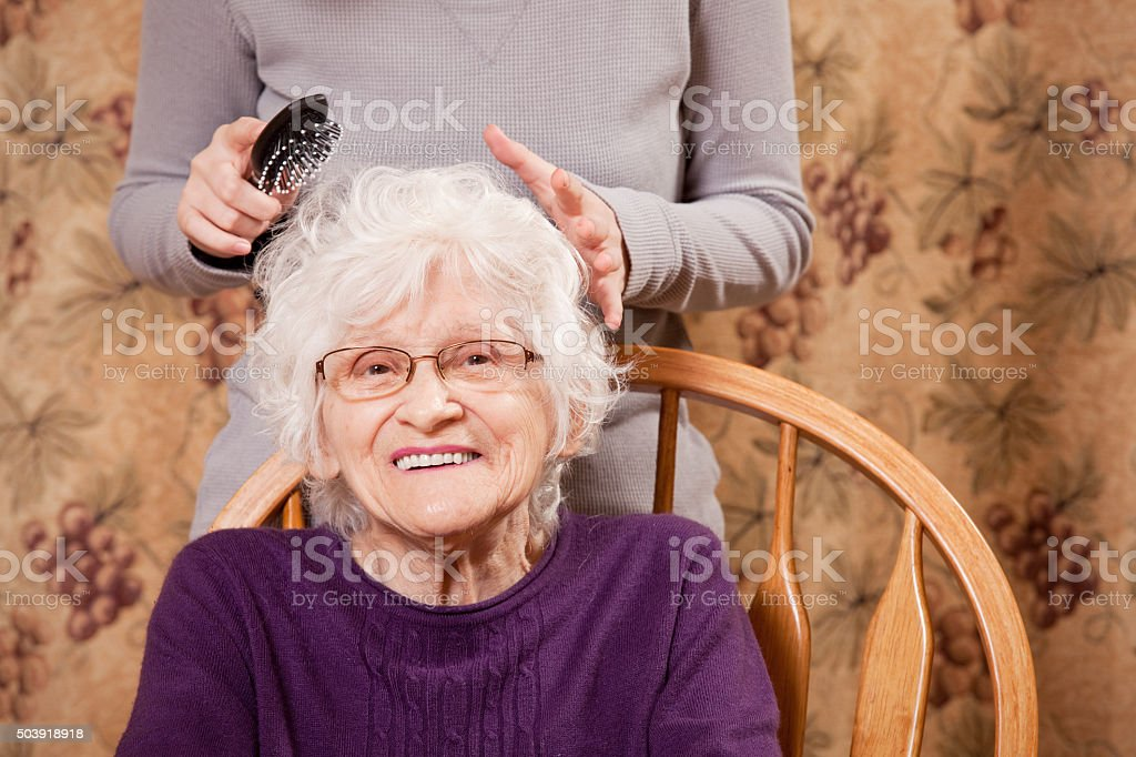 Senior Woman Getting Her Hair Styled stock photo