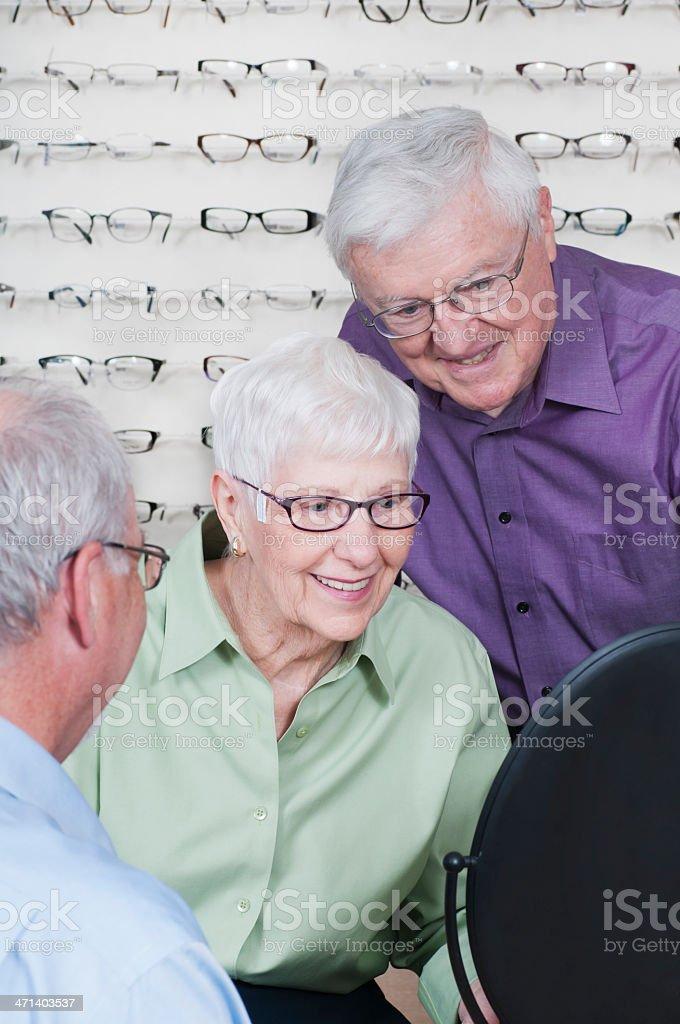 Senior Woman Getting New Eyeglasses at Optometrist royalty-free stock photo