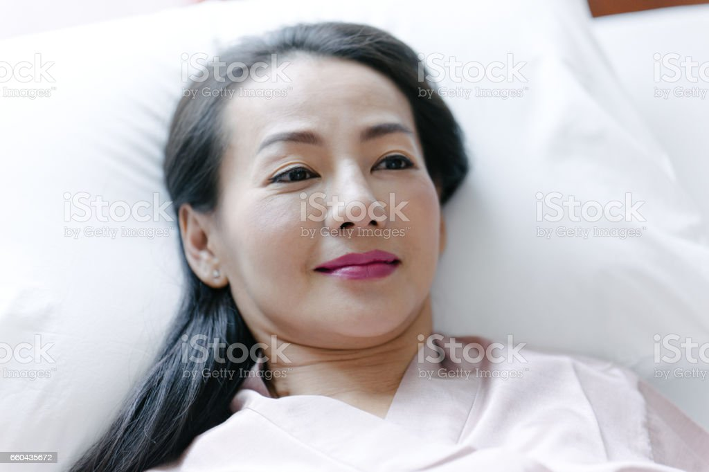 Senior woman getting ready for traditional thai massage stock photo
