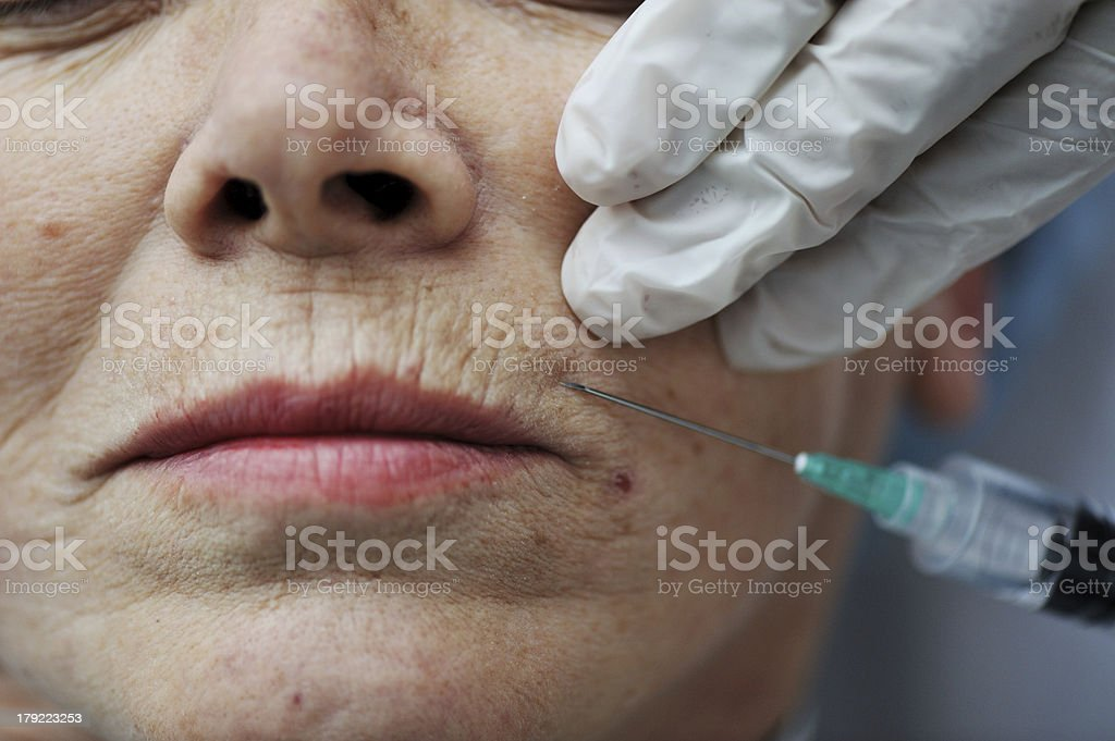 Senior woman getting skin care injection royalty-free stock photo