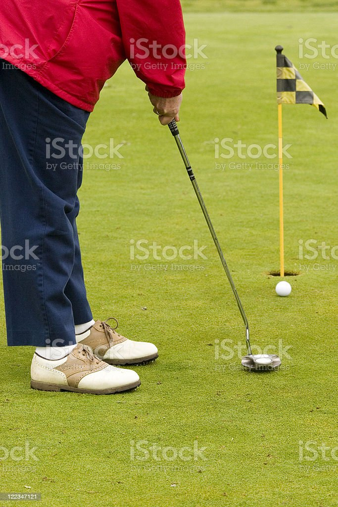 Senior Woman Golfs royalty-free stock photo
