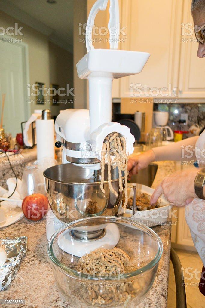 Senior woman grinding homemade chopped liver stock photo