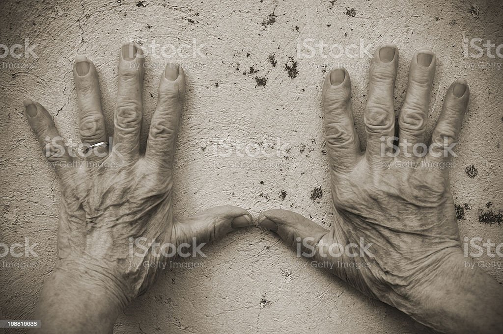 Senior Woman Hands on the wall royalty-free stock photo