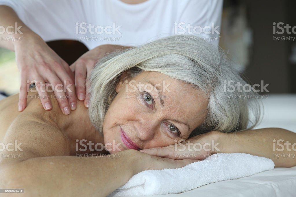 Senior woman having a massage stock photo